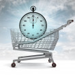 Shoping cart with blue stopwatch and sky flare — Stock fotografie