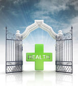 Open baroque gate with health cross and sky — Stock Photo