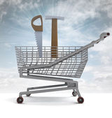 Shoping cart with hammer and saw and sky flare — Stock Photo