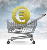 Euro coin in shoping cart with sky flare — Stock Photo
