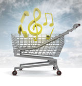 Shoping cart full of music and sky flare — Stock Photo