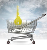 Golden key in shoping cart with sky flare — Stock Photo