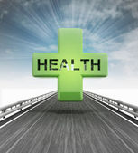 Highway with health cross with sky flare — Stock Photo