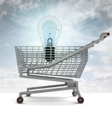 Shopping cart with shiny bulb and sky flare — Stock Photo