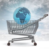 Shoping cart with africa on globe and sky flare — Stock Photo