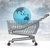 Shoping cart with asia on globe and sky flare — Stock Photo
