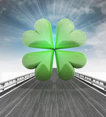 Highway with green cloverleaf and sky flare — Stock Photo
