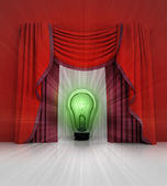 Red curtain scene with green shiny bulb and flare — Stock Photo