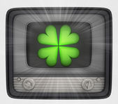 Green cloverleaf in retro television and flare — Stock Photo