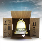 Golden holiday bell product delivery with sky flare — Stock Photo