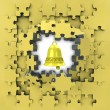Stock Photo: Yellow puzzle jigsaw with golden bell revelation