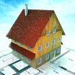 Real estate house with layout plan at snowfall — Stock Photo