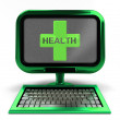 Green metallic computer with health cross on screen isolated — Stock Photo