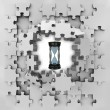 Stock Photo: Grey puzzle jigsaw with sand glass time revelation