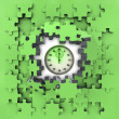 Green puzzle jigsaw with stopwatch revelation — Stock Photo