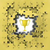 Yellow puzzle jigsaw with champion cup idea revelation — Stock Photo
