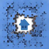 Blue puzzle jigsaw with house icon revelation — Stock Photo