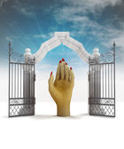 Divine hand help in heavenly gate with sky flare — Stock Photo