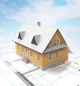 Classical mountain cottage with layout plan at winter snowfall — Stock Photo
