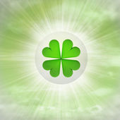 Cloverleaf luck in glossy bubble in the air with flare — Stock Photo
