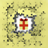 Yellow puzzle jigsaw with mystery gift idea revelation — Stock Photo