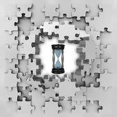 Grey puzzle jigsaw with sand glass time revelation — Foto de Stock