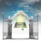 Bell ringing welcome to heavenly gate with sky flare — Stock Photo