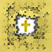 Yellow puzzle jigsaw with golden cross idea revelation — Stock Photo