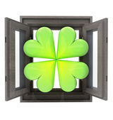 Isolated opened house window with cloverleaf happiness symbol — Stock Photo