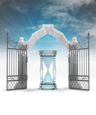 Sand-glass counting time in heavenly gate with sky flare — Stock Photo