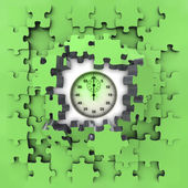 Green puzzle jigsaw with stopwatch revelation — Stockfoto