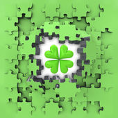 Green puzzle jigsaw with cloverleaf lucky revelation — Stock Photo