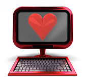 Red metallic computer with love symbol on screen concept isolated — Stock Photo