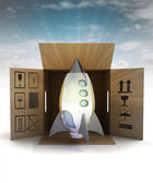Space ship toy product delivery with sky flare — Stok fotoğraf