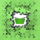 Green puzzle jigsaw with shopping basket revelation — Stock Photo