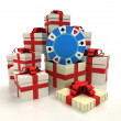 Isolated group of christmas gift boxes with poker chip revelation — Stock Photo