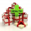 Isolated group of christmas gift boxes with health cross revelation — Stock Photo