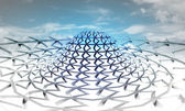 Abstract blue three dimensional circular building with sky background — Stock Photo