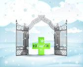 Xmas gate entrance with health cross in winter snowfall — Stock Photo
