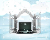 Xmas gate entrance with heavenly laptop in winter snowfall — Stock Photo