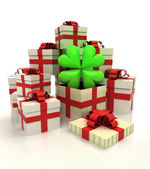 Isolated group of christmas gift boxes with cloverleaf happiness revelation — Stock Photo