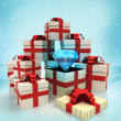 Christmas gift boxes with big diamond surprise at winter snowfall — Stock Photo #35941777