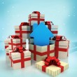 Stock Photo: Christmas gift boxes with new house surprise at winter snowfall