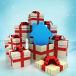 Christmas gift boxes with new house surprise at winter snowfall — Stock Photo