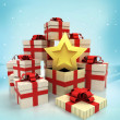 Christmas gift boxes with top star surprise at winter snowfall — Stock Photo