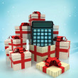 Christmas gift boxes with business calculator surprise at winter snowfall — Stock Photo