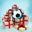 Christmas gift boxes with soccer ball surprise at winter snowfall — Stock Photo