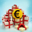 Christmas gift boxes with Euro coin surprise at winter snowfall — Stock Photo