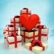 Christmas gift boxes with love surprise at winter snowfall — Stock Photo