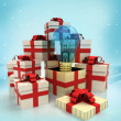 Christmas gift boxes with blue shiny bulb surprise at winter snowfall — Foto de Stock